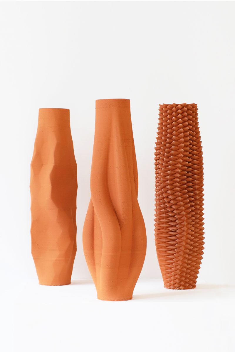 Functional Ceramics by Olivier van Herpt, image of three terracotta colored vases.