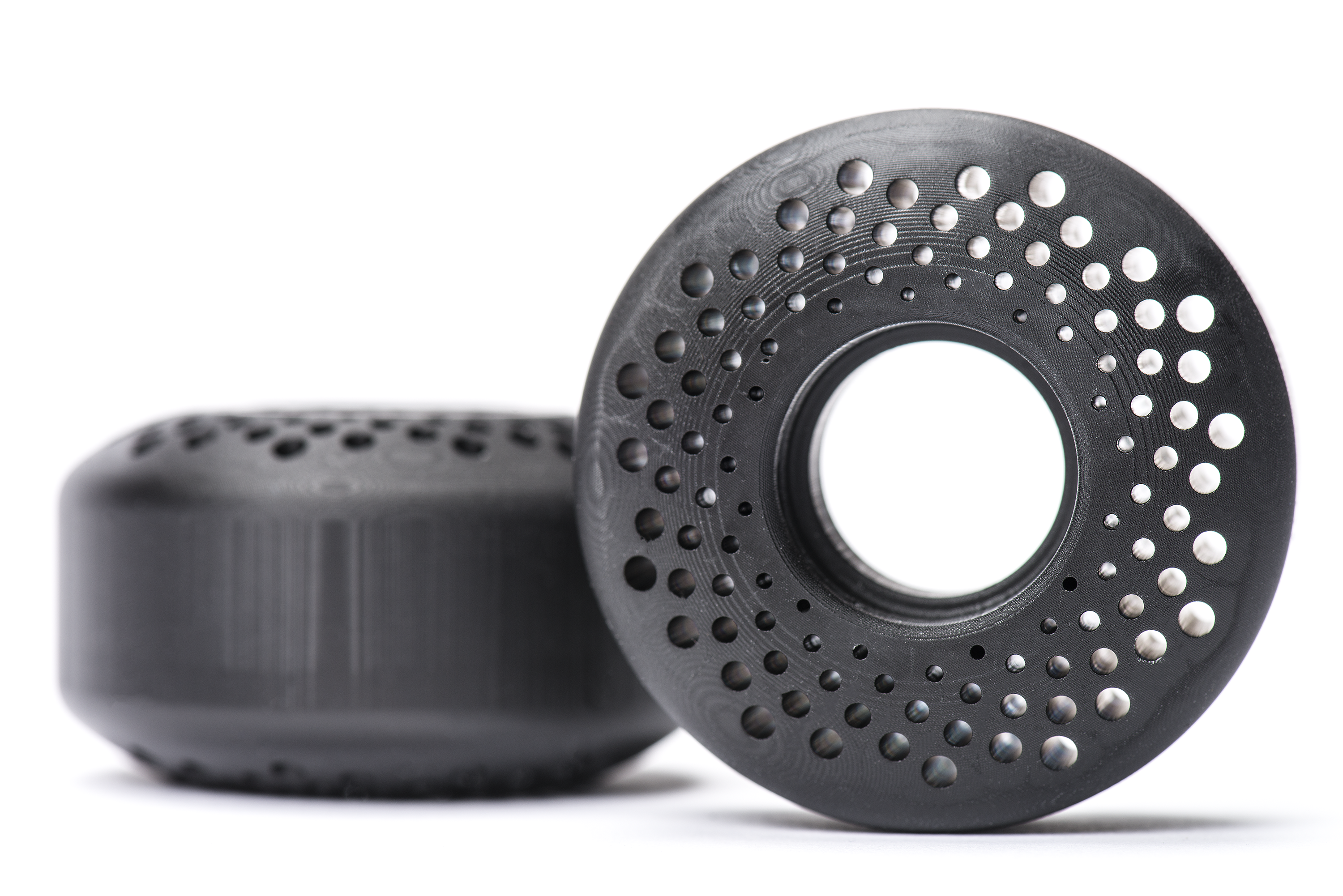Skateboard wheels 3D printed with Carbon$0027s FPU material. Photo via Protolabs.